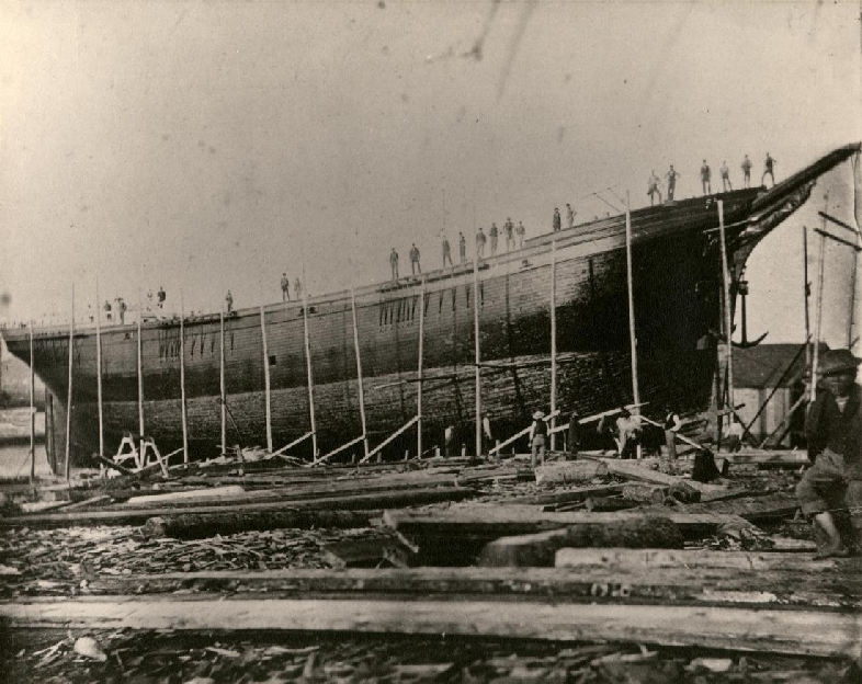 The Revolving Light while under construction at the Turner Shipyards in Harvey in 1875. The ship was the first square rigged all masts built at Harvey. The ship weighed 1248 tons and was named for Cape Spencer Light, Saint John.