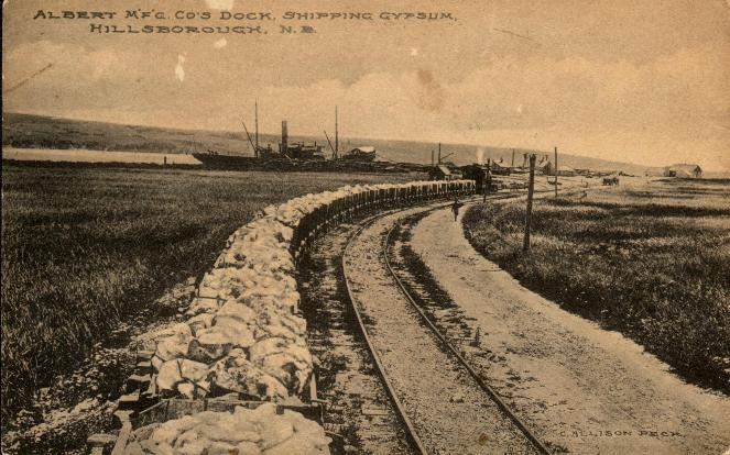A train hauling cars loaded with gypsum to the Albert Manufacturing Company Mill in Hillsborough.   1911   Hillsborough, New Brunswick, Canada