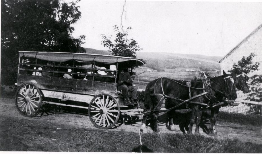 Horse powered van was used to transport students to the Riverside Consolidated School in the summer.   1905