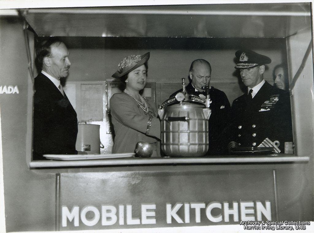 R.B. Bennett with Queen Elizabeth in a mobile kitchen Circa 1942 England