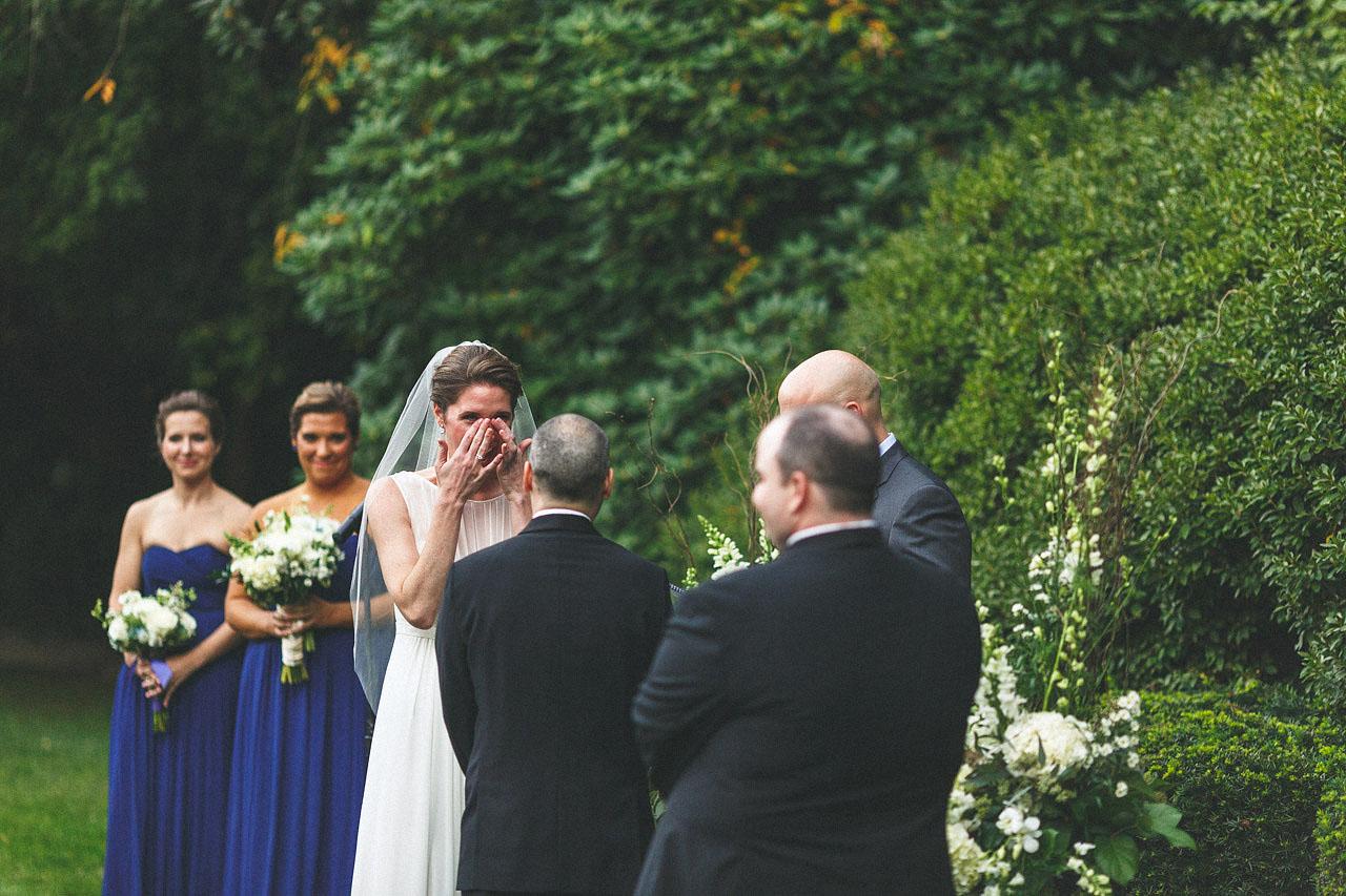 Bride wipes away tear