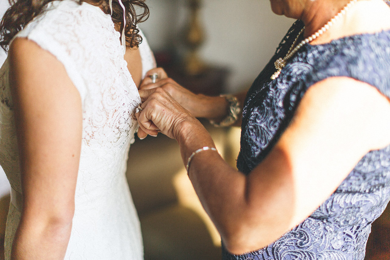 Mom helping Daughter into Dress