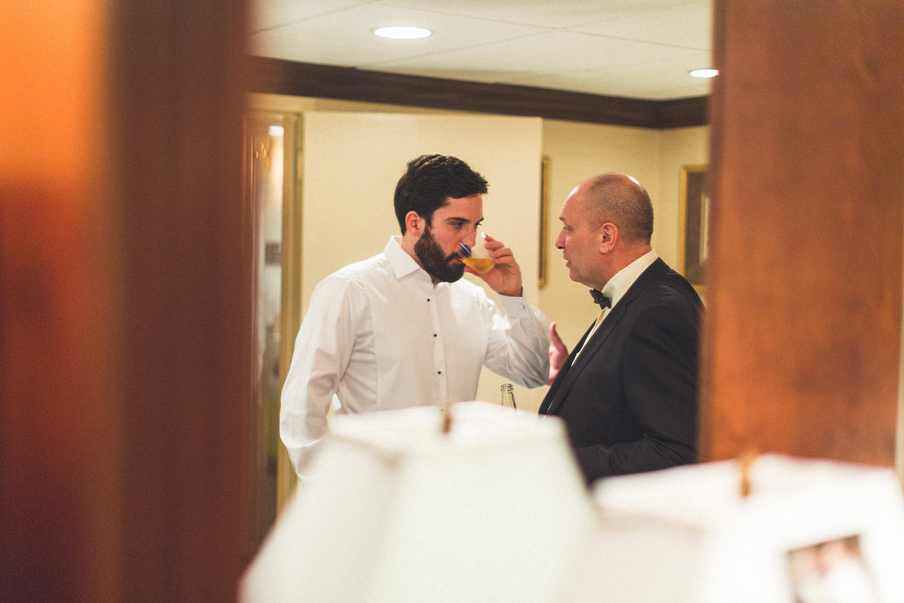 Groom listens to Father of the Bride