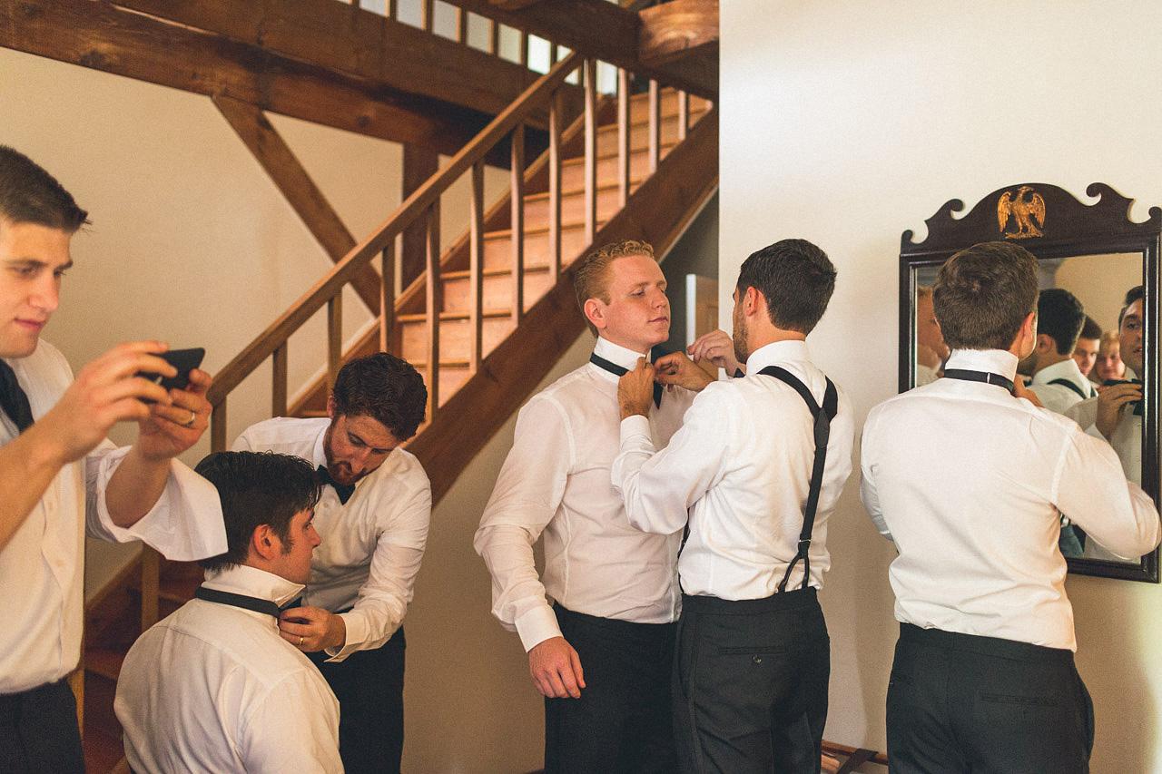 Groomsman work on bow ties