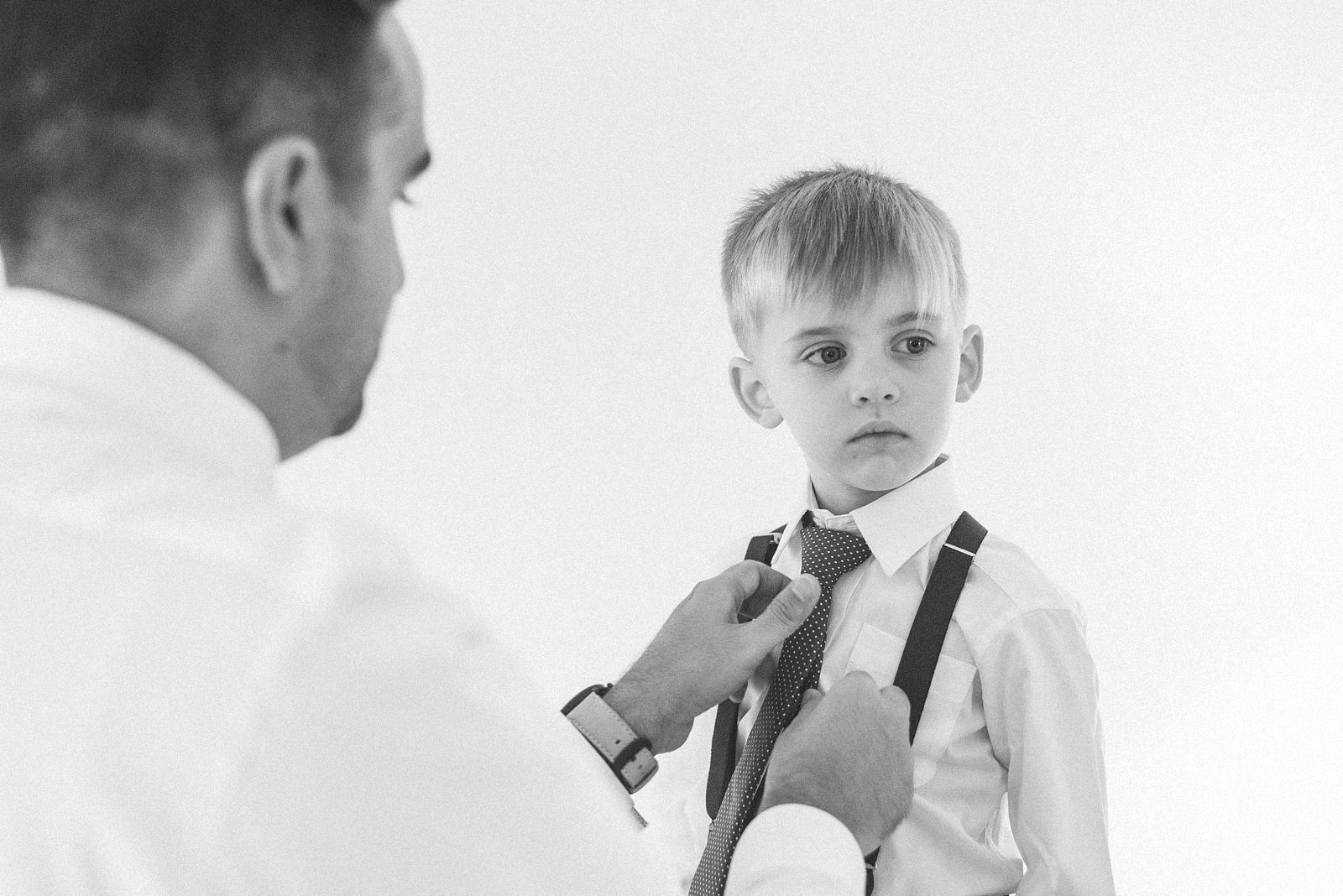 Groom helps son get ready