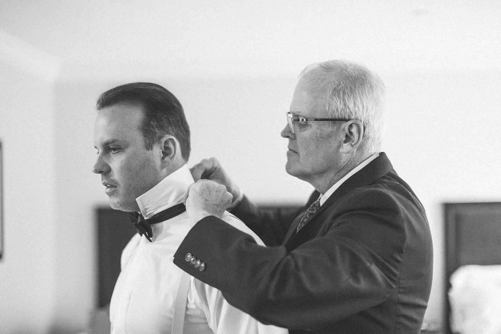 Father helps Groom with bowtie