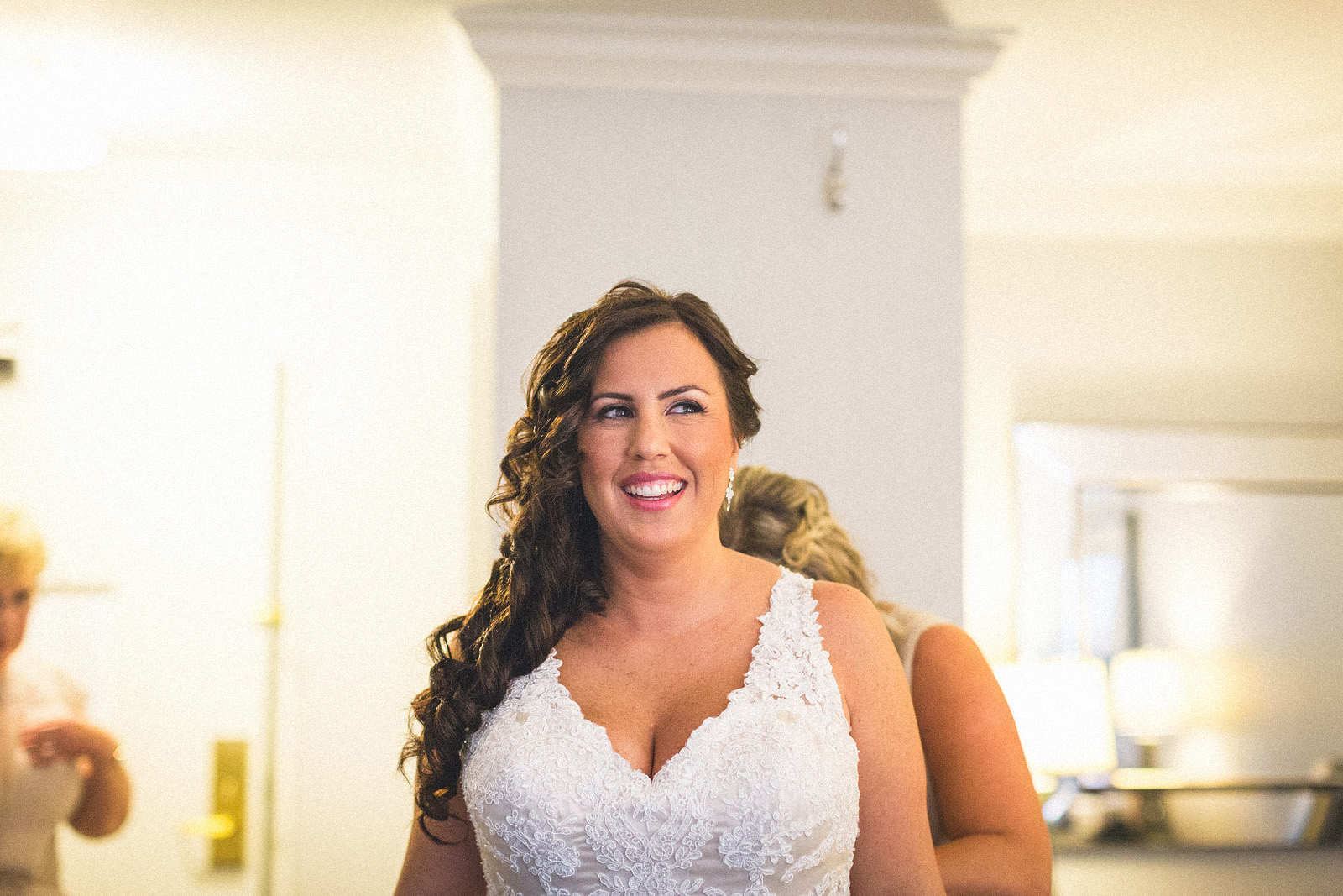 Bride smiles while getting ready