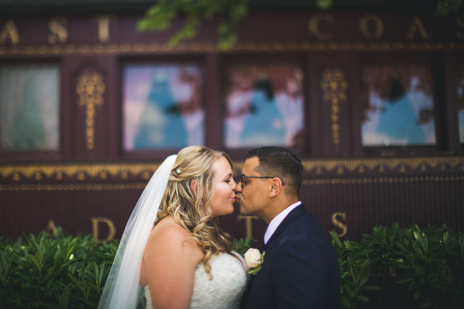 Kiss in front of Train Madison Hotel Morristown New Jersey Wedding