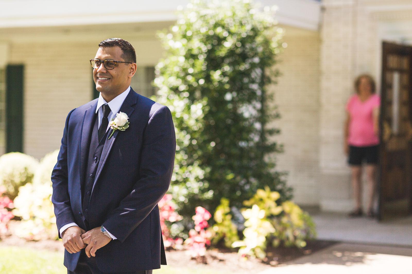 Groom waits to see Bride