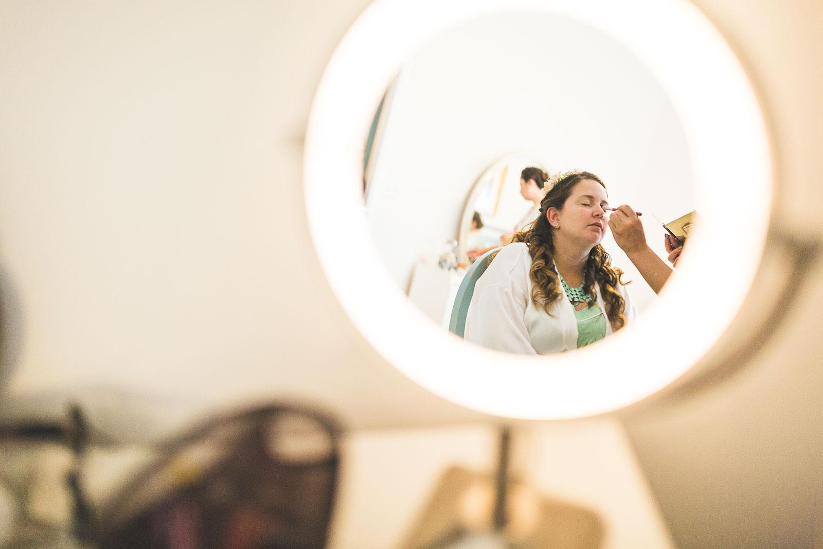 Bride getting makeup done