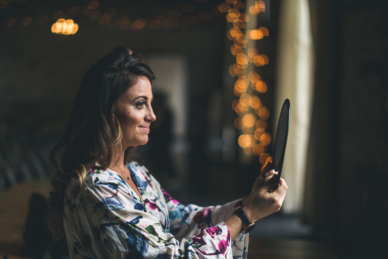 Bride admires makeup