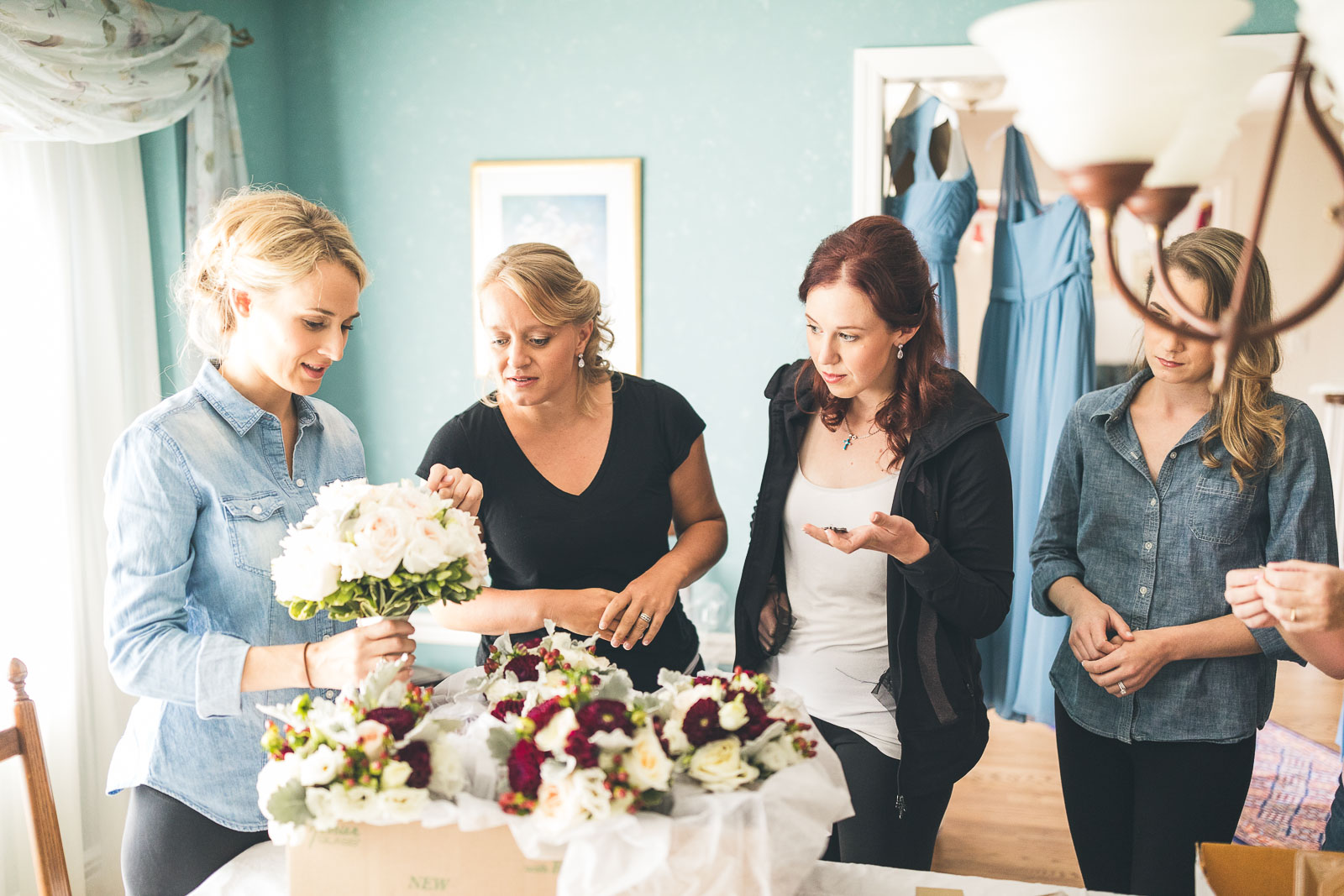 Bride looks at flowers