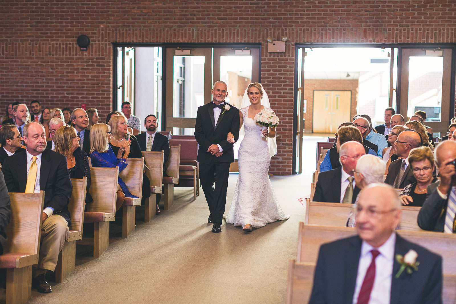 Father of Bride Walks down aisle