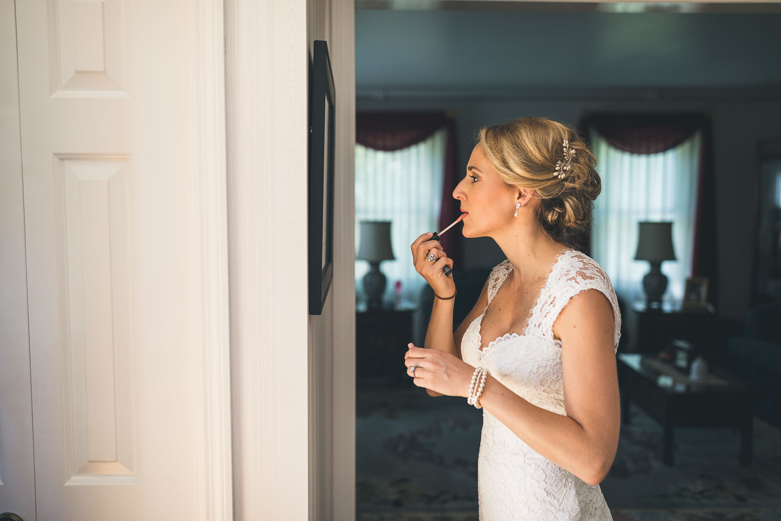 Bride applies finishing touches