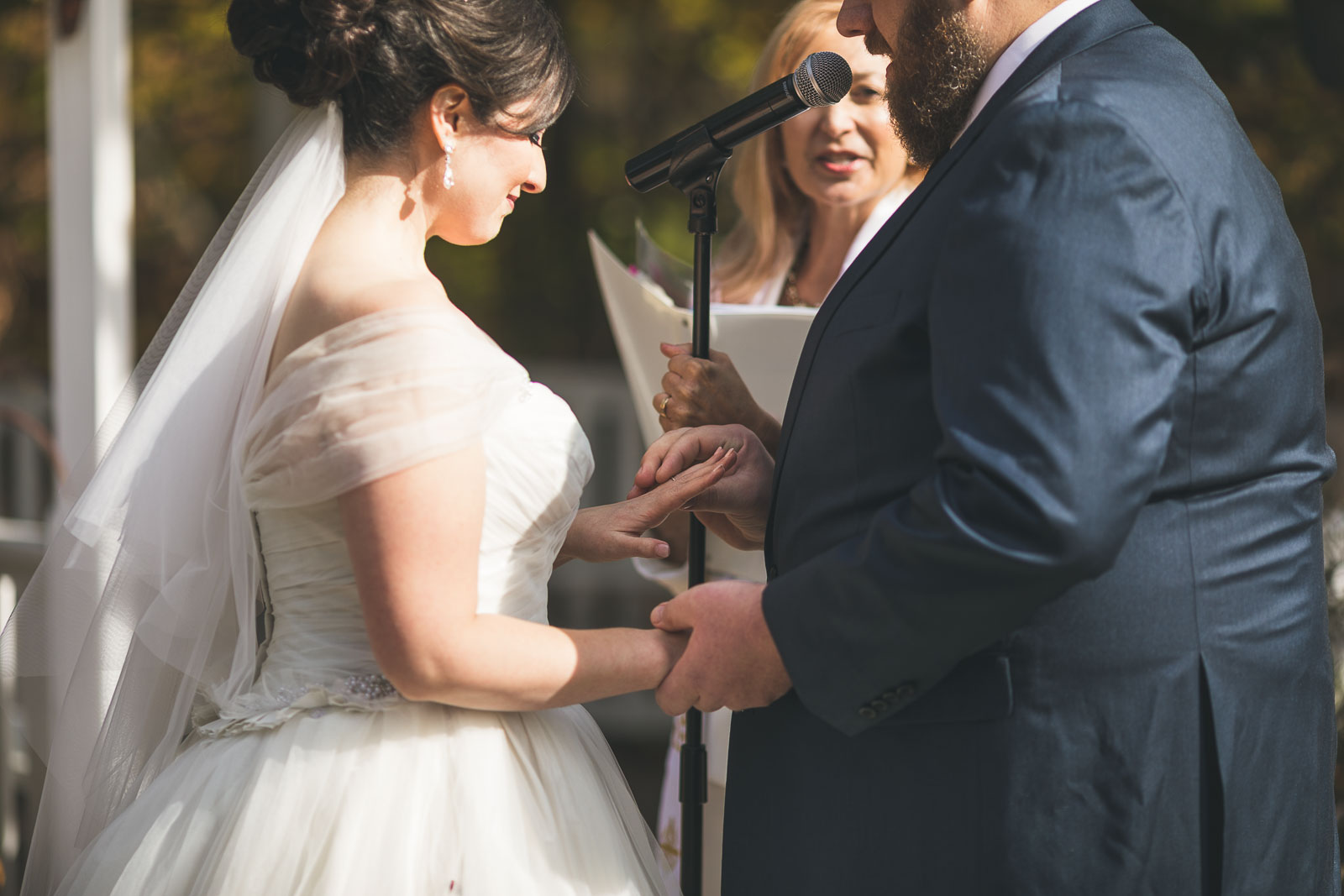 Groom exchanges ring with bride