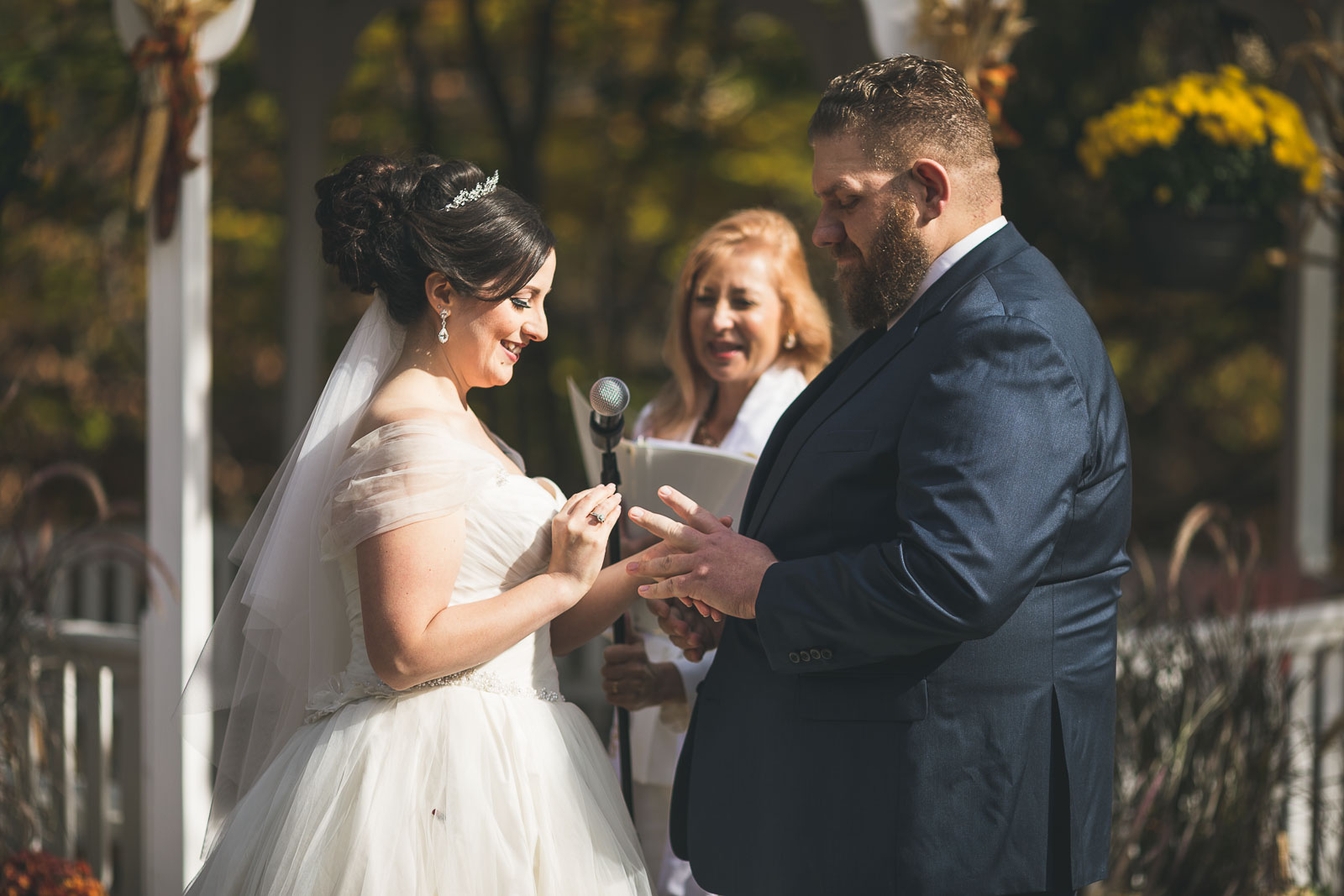 Bride sheds a tear exchanges ring with groom