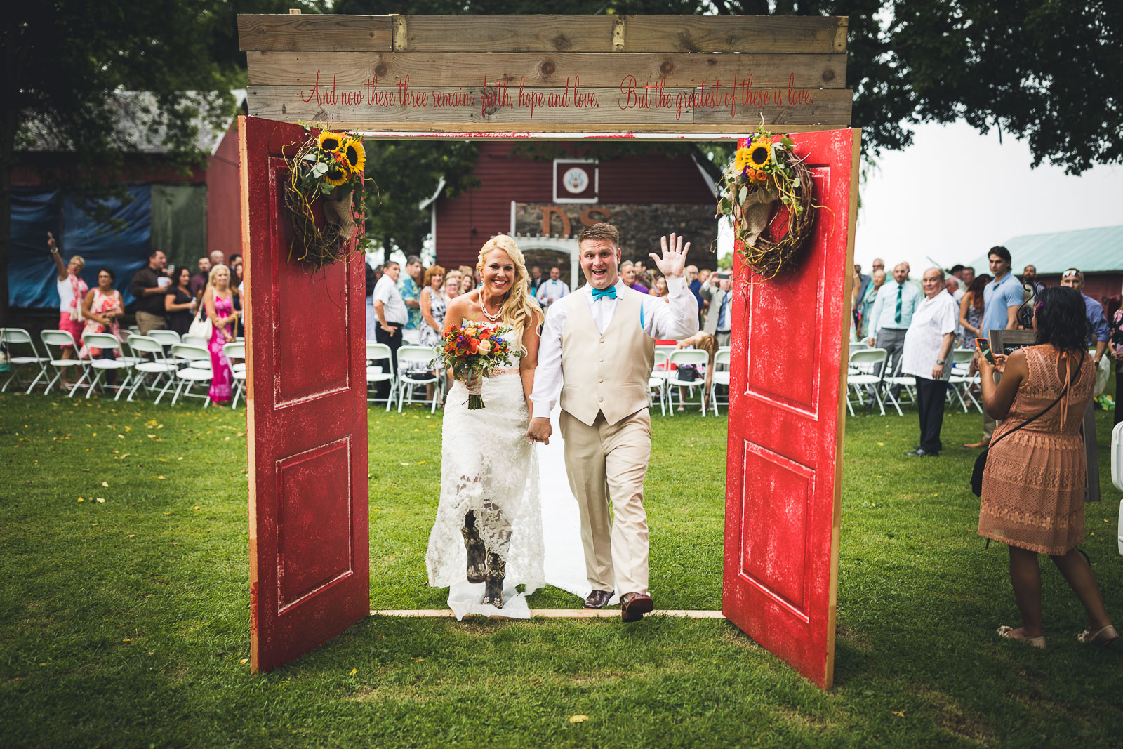 Bride and Groom walk through doors farm wedding