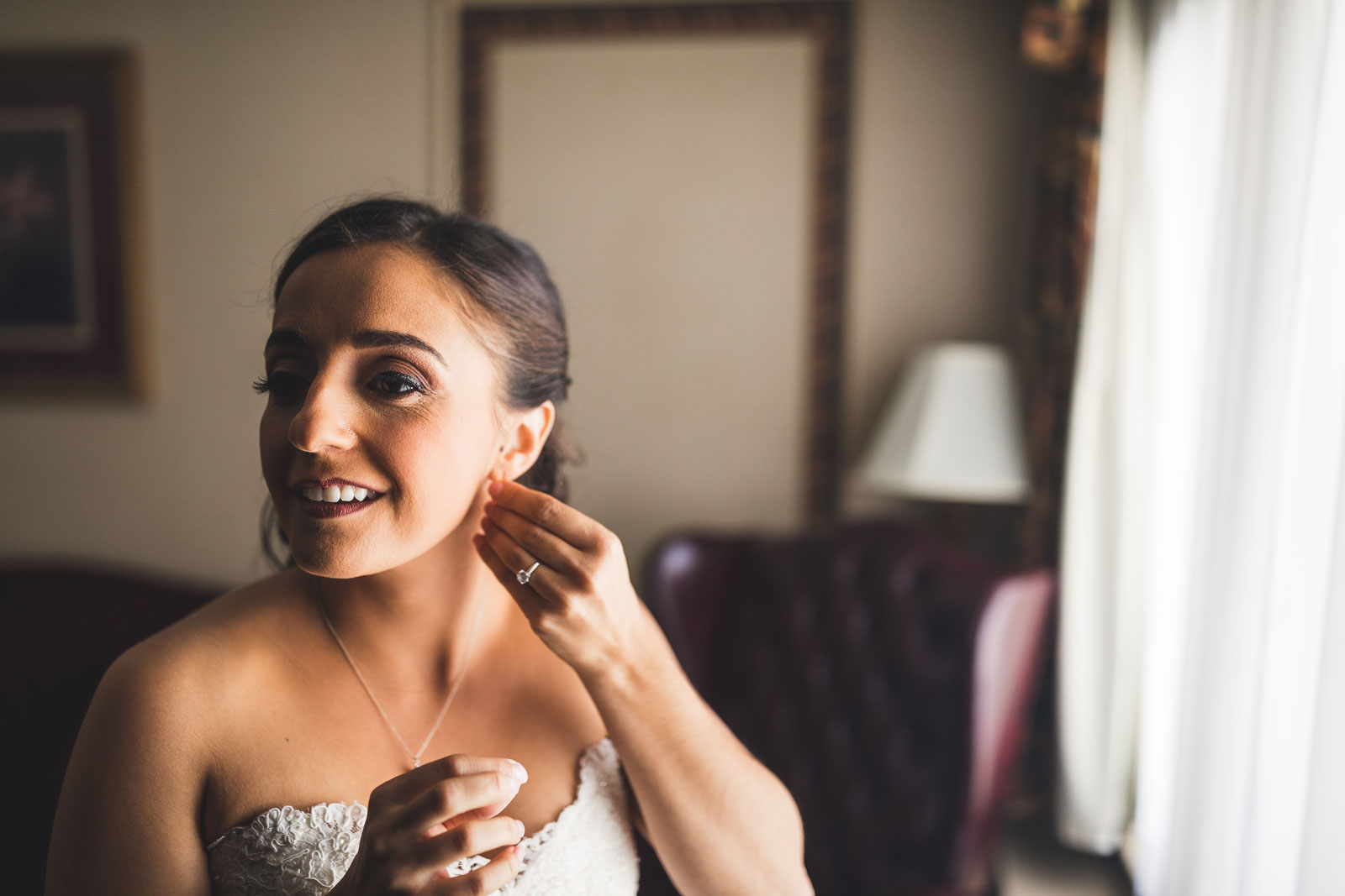 Bride puts on ear rings
