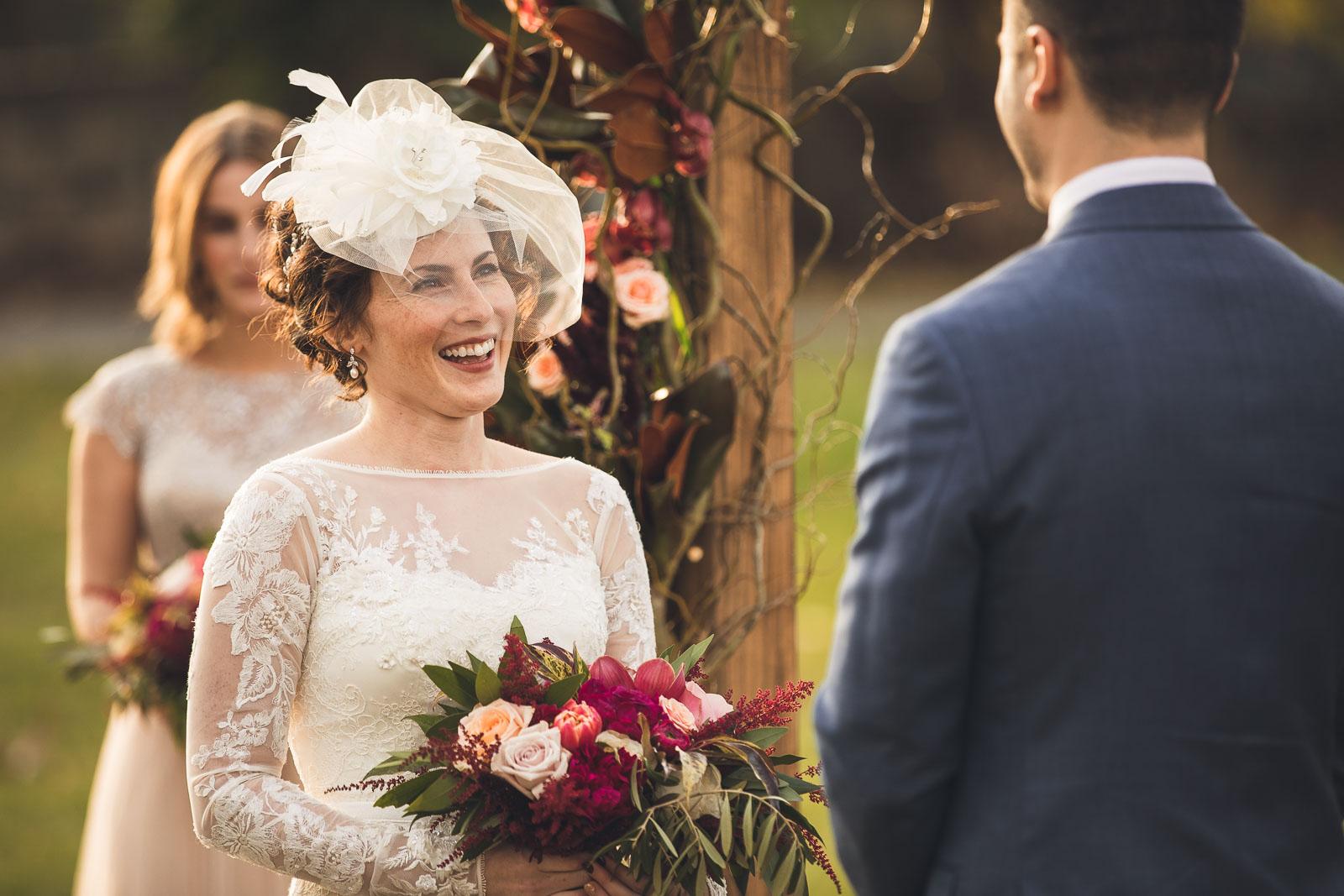 Bride laughs during ceremony Orange Lawn Tennis Club