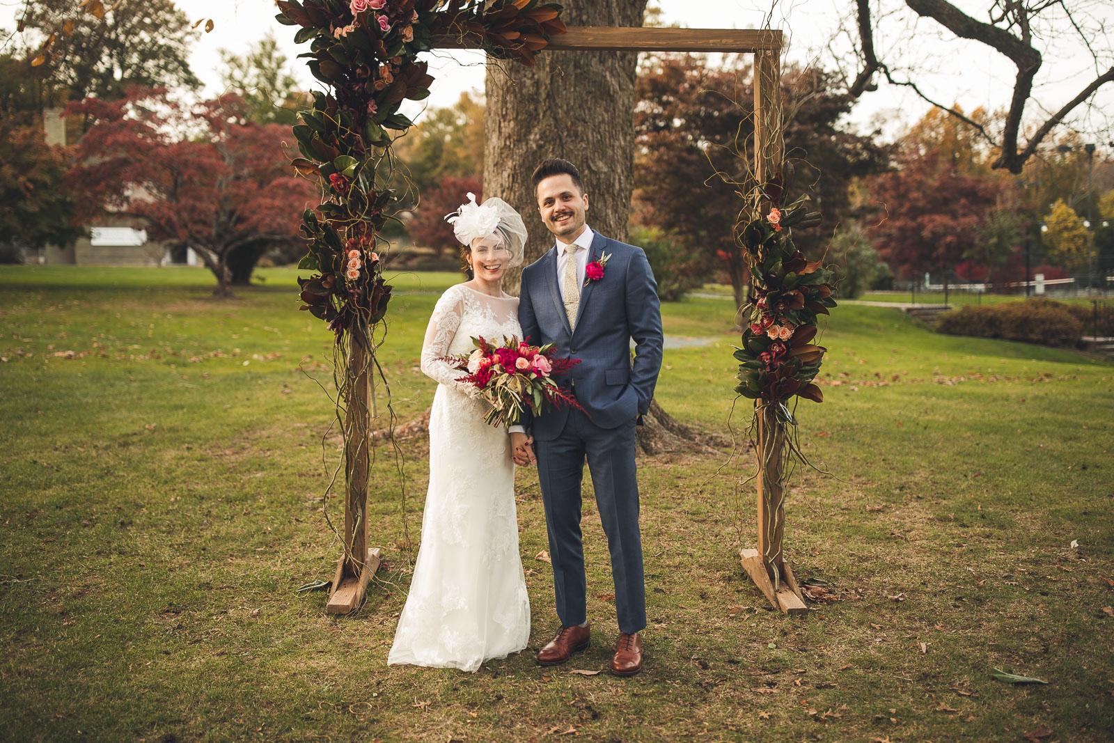 Photo under the Wedding Arch