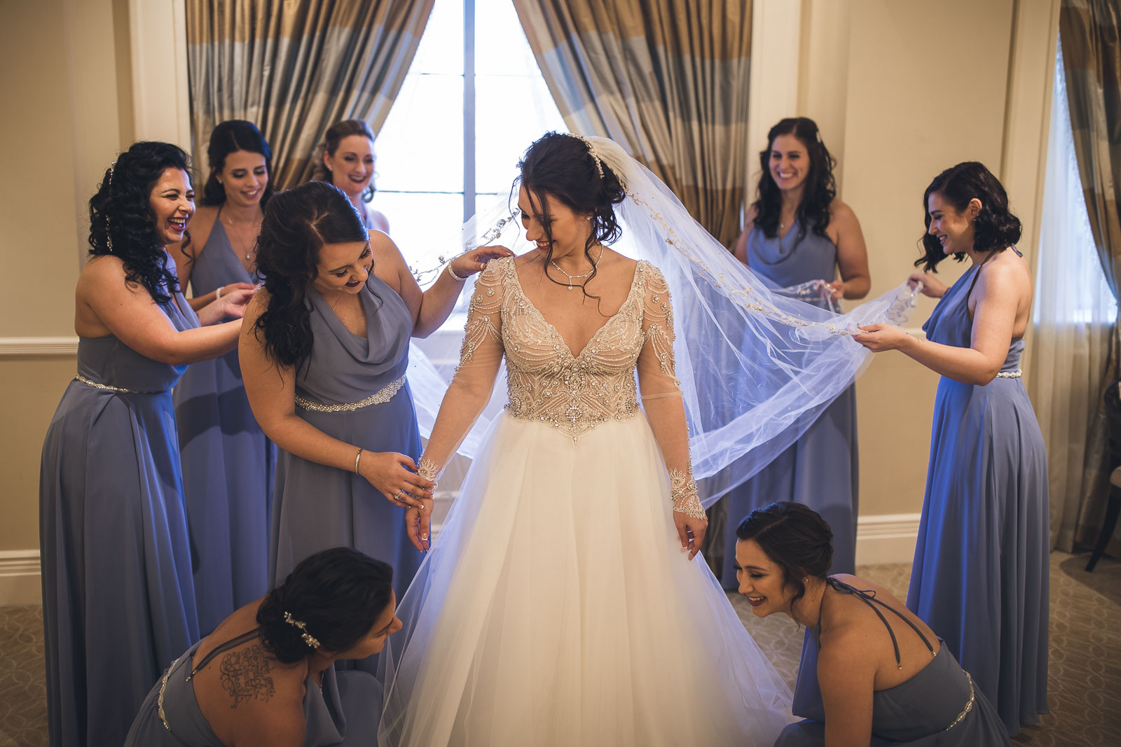 Bridal Party helps with dress at The Grove