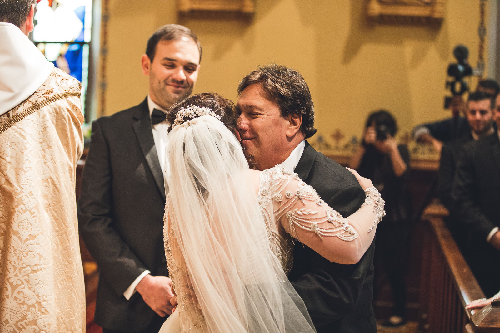 Bride and Father Embrace