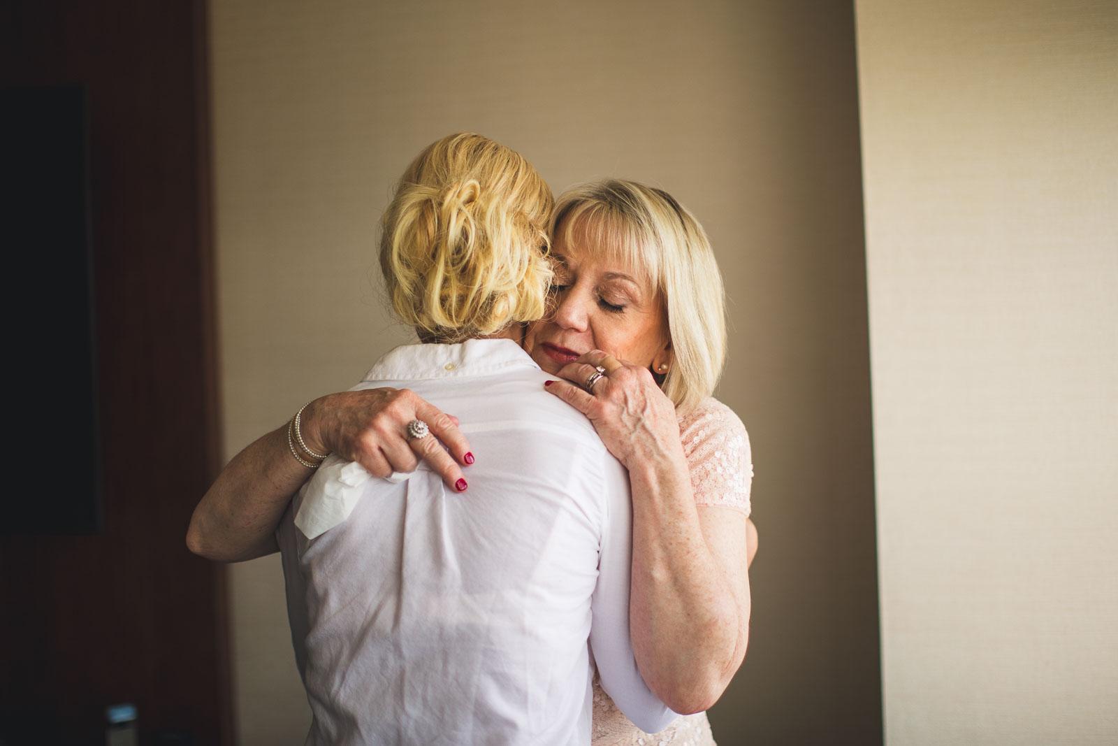 Mom hugs Bride