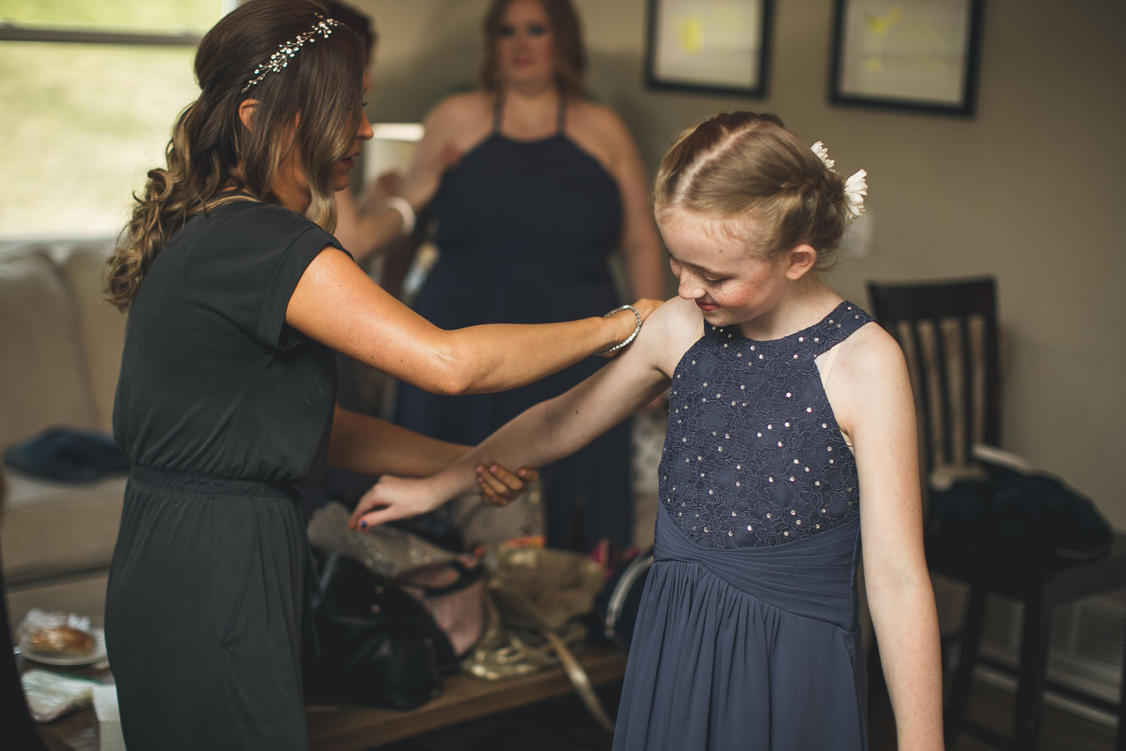 Bride helps Junior Bridesmaid Lotion Up