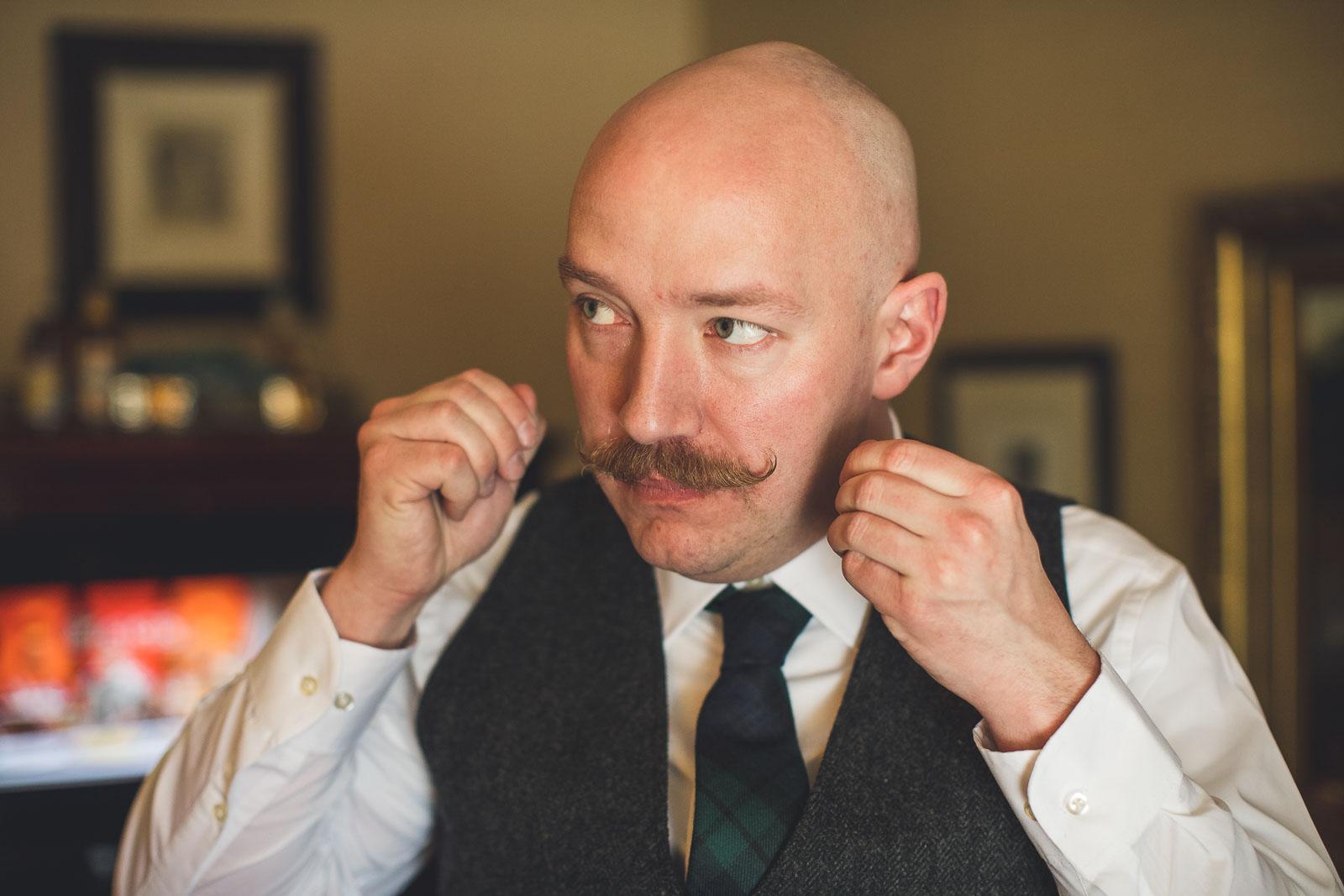Groom styling mustache