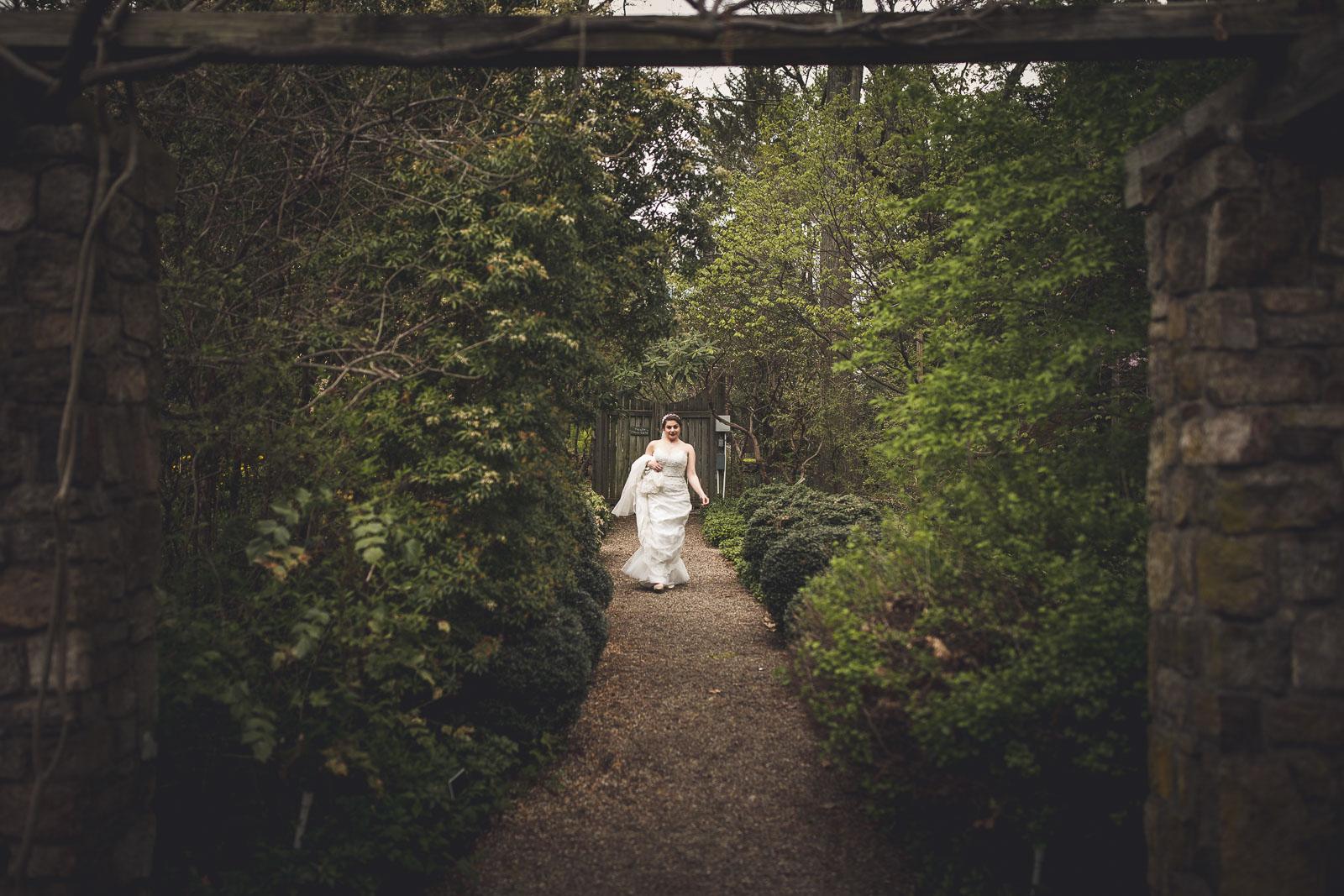 Bride walking to first look Cross Estate Gardens