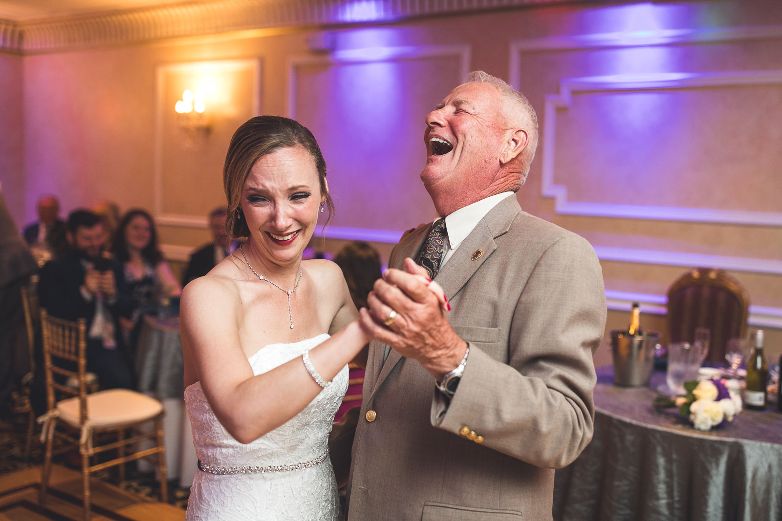 Father laughs with Bride