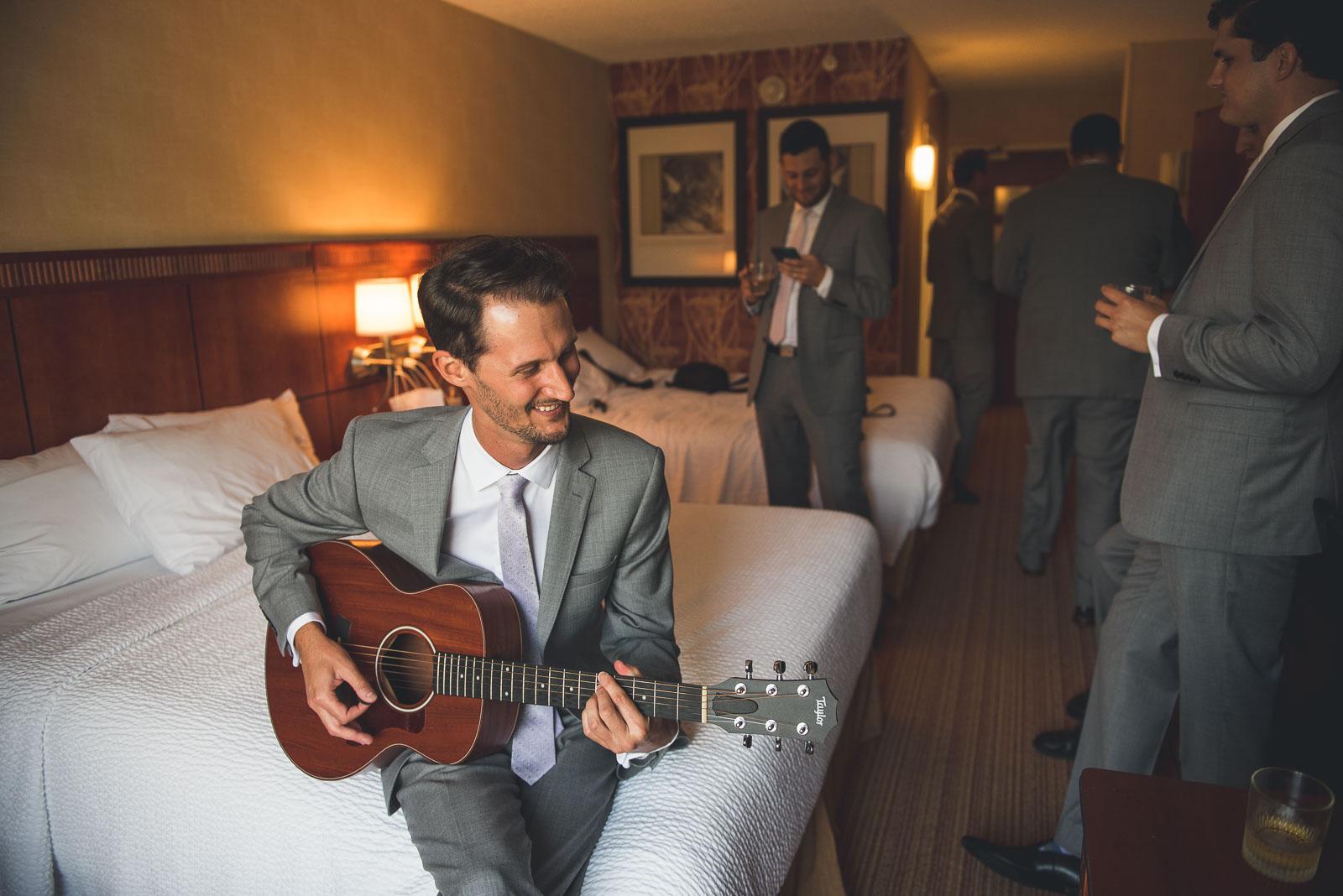 Groom plays guitar