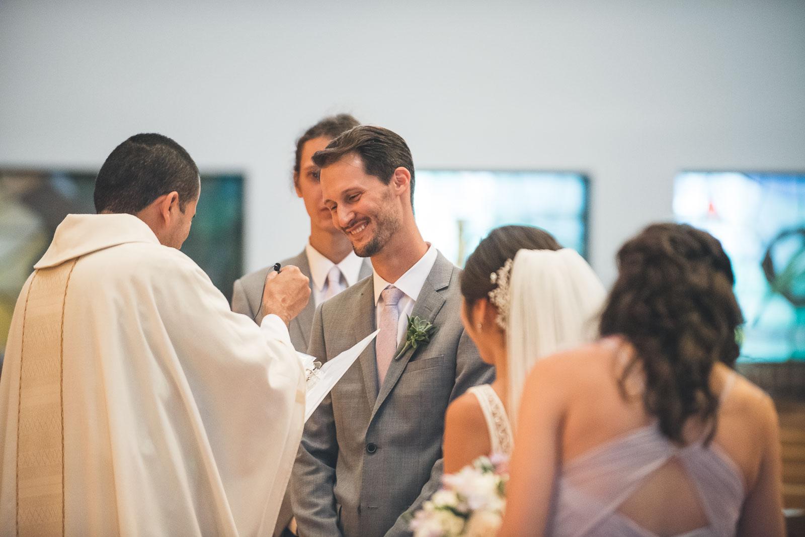 Groom laughs Wedding Ceremony