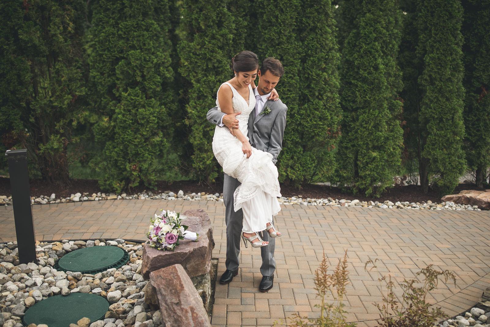 Groom helps Bride get down