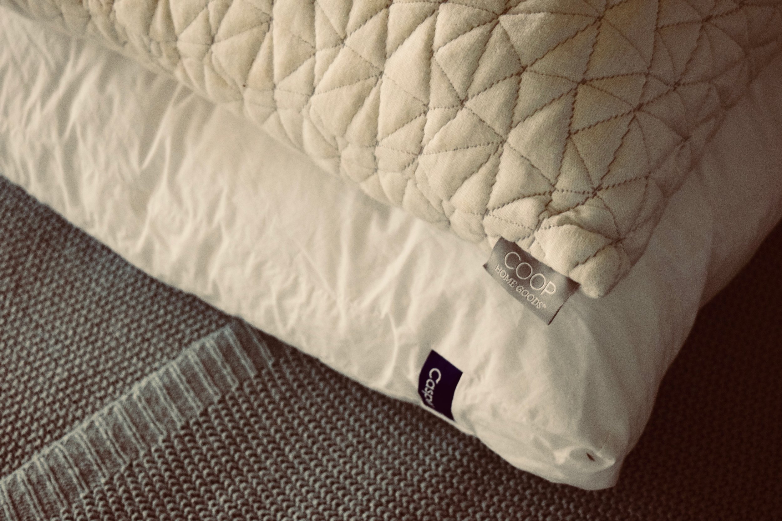 Need to get a better night's sleep? In this article you'll read a few tips you can use to get a more restful night's sleep. Pictured: Two pillows on top of one another, the Coop Pillow and the Casper Pillow