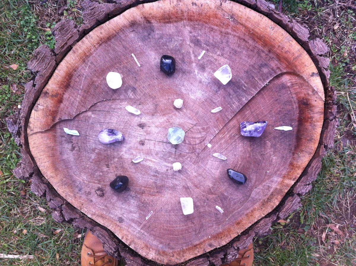 Article: How To Cope When Someone Is Mean To You Picture: Crystal Grid on Wooden Stump by Amanda Linette Meder