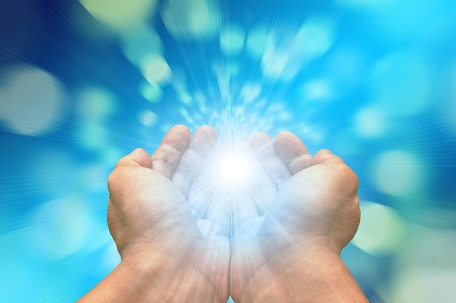 Hands holding healing energy. Image by  Gerd Altmann  from  Pixabay