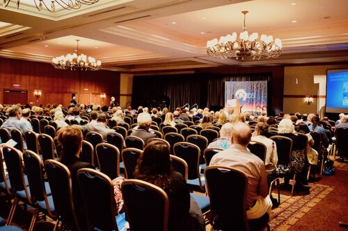 Near Death Experience Scientific Research Presentation, Yvonne Kason. Image conference hall for NDE 2019 Amanda Linette Meder
