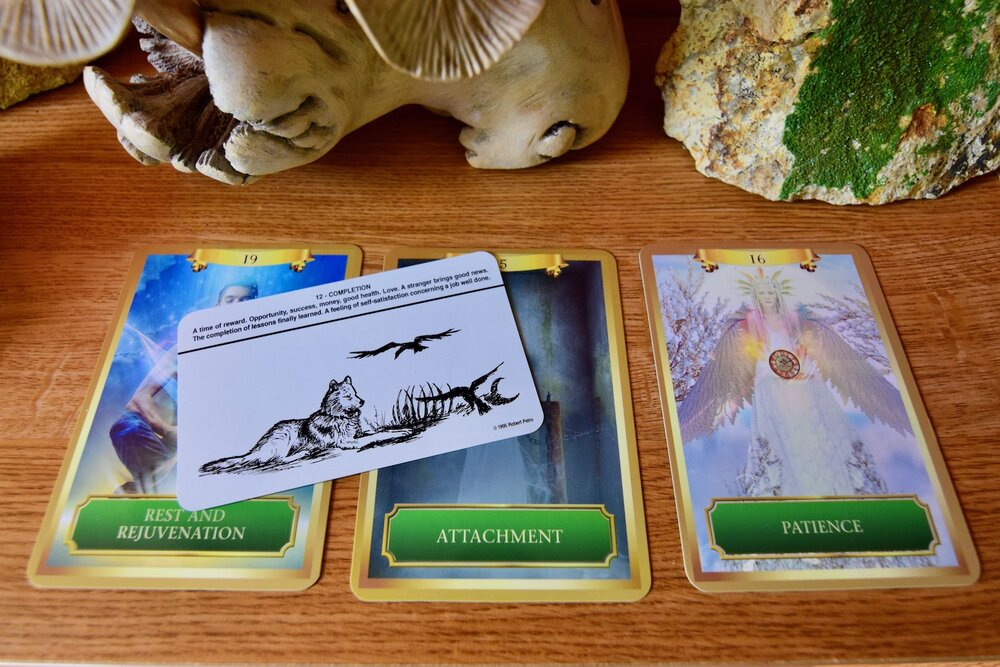 Photo of right-side up Completion card overlaid on a Rest and Rejuvenation, Attachment and Patience Energy Oracle Cards a bookshelf by Amanda Linette Meder