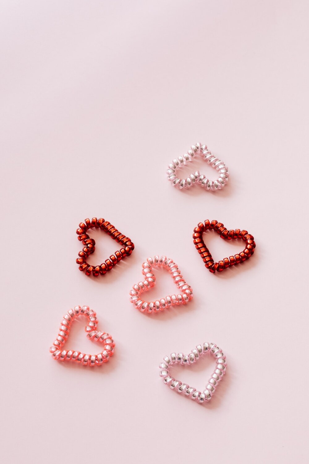 Vertical photo of six scattered heart shaped coils by Karolina Grabowska from Pexels