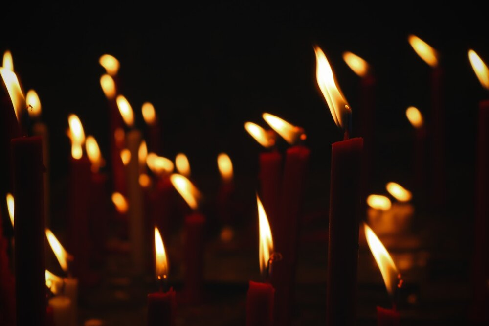 Photo of many candles burning in dark atmosphere by Maruf Bijoy from Pexels