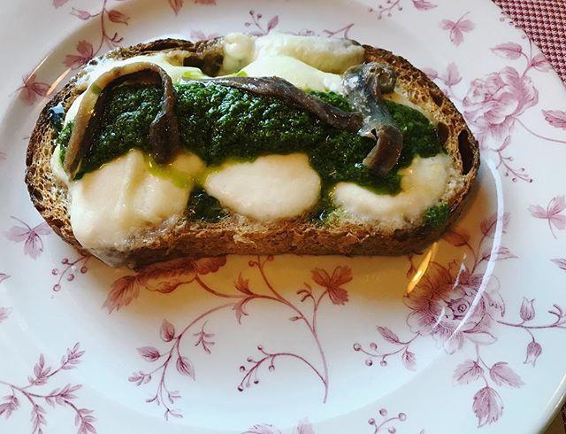 [Simplicity] Mozzarella topped with a most  garlicky pesto and anchovies.  Mountain meets lake kinda feel.  #northernitalianfood #anchovies #pesto