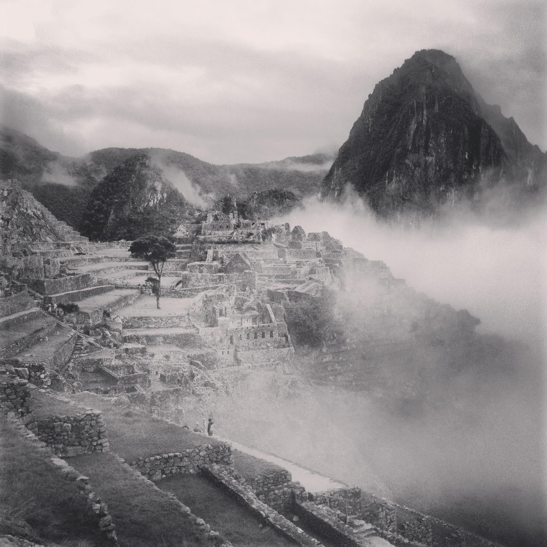 Machu Picchu in early morning fog