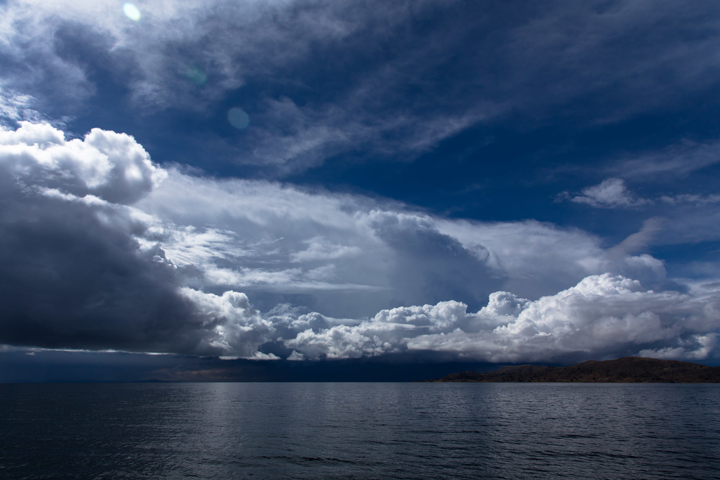 A storm on the horizon as our small ferry passes the Llachon peninsular.
