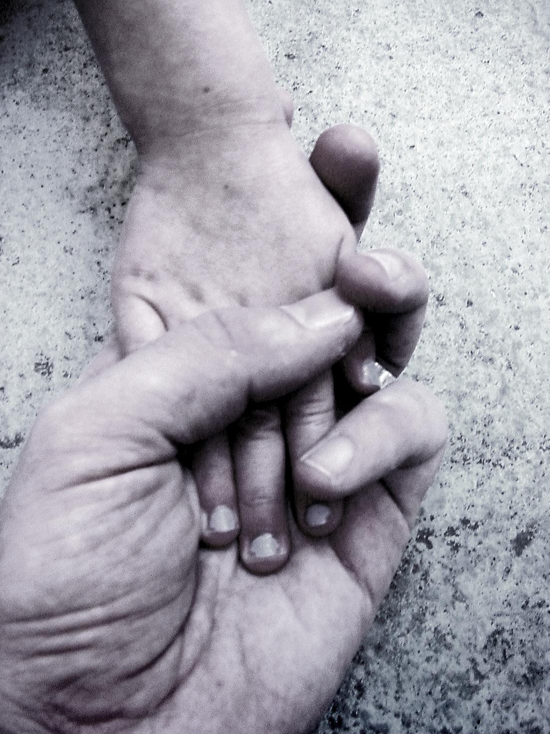 man-holding-childs-hand.jpg