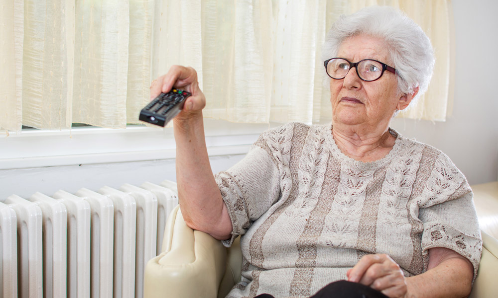Woman changing the TV channel