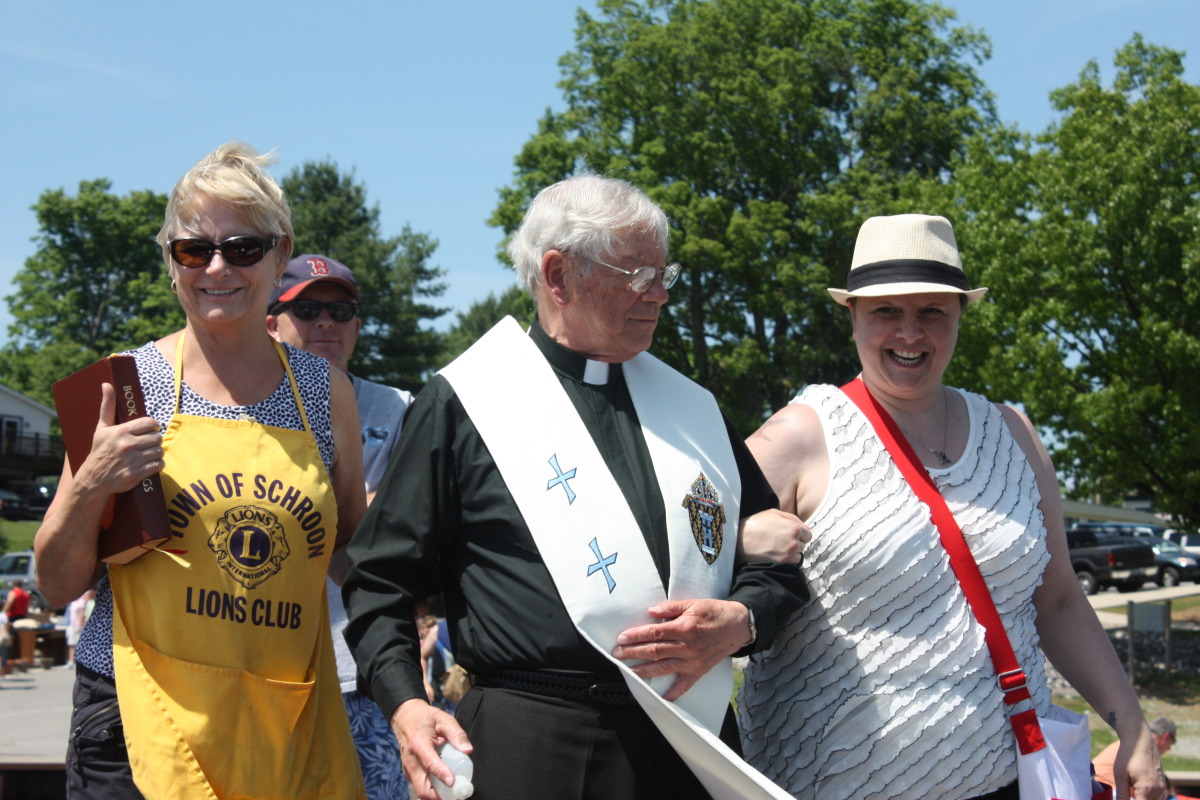 Anne Gregson, a local Priest and Shelby Davis at the Blessing of the Fleet