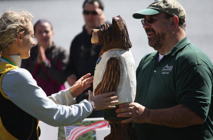 Adirondack marathon and distance festival director joel friedman presenting a runner with a bear. SCHROON LAKER COLLECTION. ALL RIGHTS RESERVED.