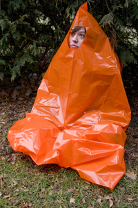 You can create a quick shelter rom rain or cold using a heavy-duty trash bag with a hole cut out for your face.