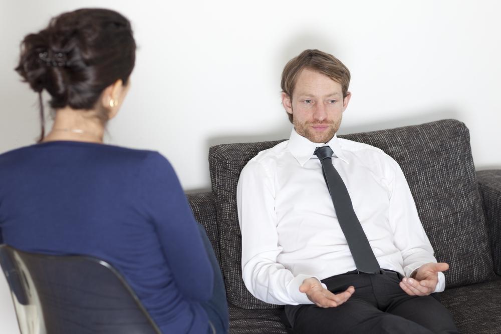 steph counseling a man.JPG